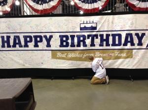 Signing Bob Uecker's birthday poster!