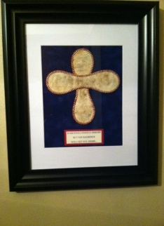 "Under the cross it says: ""EVERYONE COMMITS ERRORS, BUT HIS SACRIFICE WILL GET YOU HOME..."""